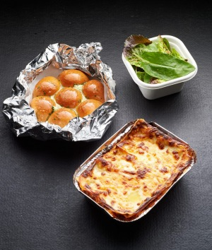 Takeaway lasagne, salad and pull-apart garlic bread from Attica restaurant.