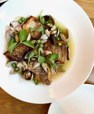 Small Town's snapper with peas, smoked pork, shiitake and a kombu broth.
