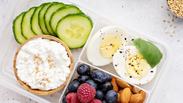 Lunch or snack box with high protein food, cottage cheese, nuts and eggs Healthy snacks, healthy food generic iStock
