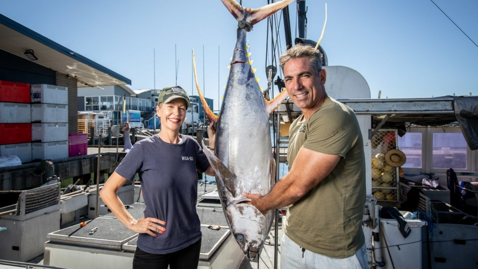 Pavo and Heidi Walker bringing in a whole yellowfin tuna at their packing facility in Mooloolaba, Queensland.