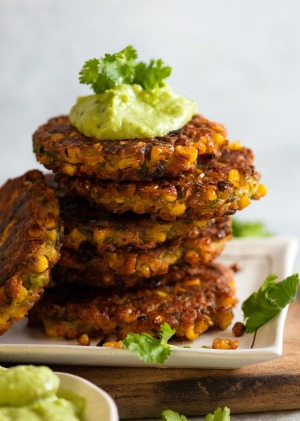 Crispy corn fritters with avocado cream.