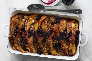 Baked French toast with almond and blueberry maple sauce.