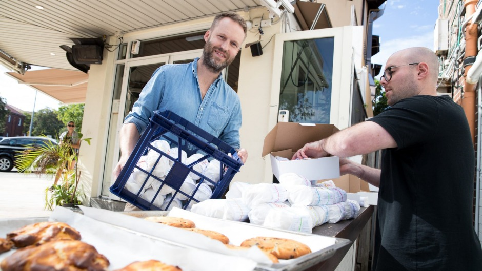 James Meek (left) and Cliff Baskin package up cookie dough for sale at their Bondi cafe.