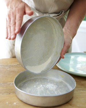 Lining or dusting your pan with flour will prevent your cake from sticking.