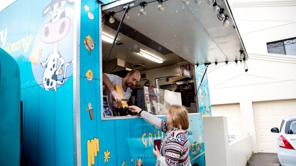 Say cheese: Beau Lange grills raclette cheese from his Dairy Extraordinary food truck in the Sydney suburb of Kingsgrove.