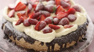 Hazelnut gateaux with chocolate ganache, whipped cream and strawberries.