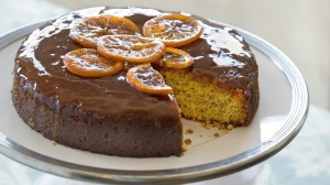 Orange and poppy seed cake with syrup and candied citrus.