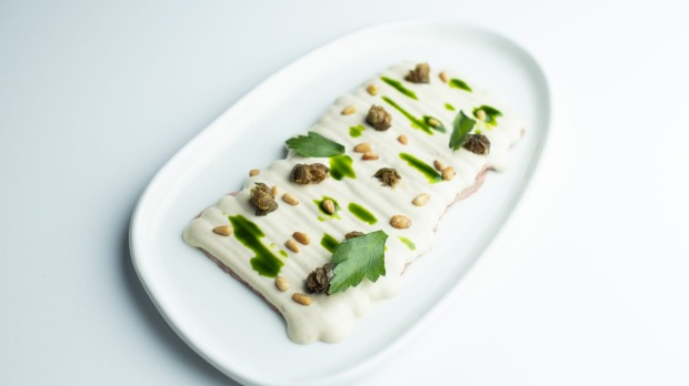 Chiosco's signature vitello tonnato, slow-cooked veal, tuna mayonnaise, fried capers, parsley oil.
