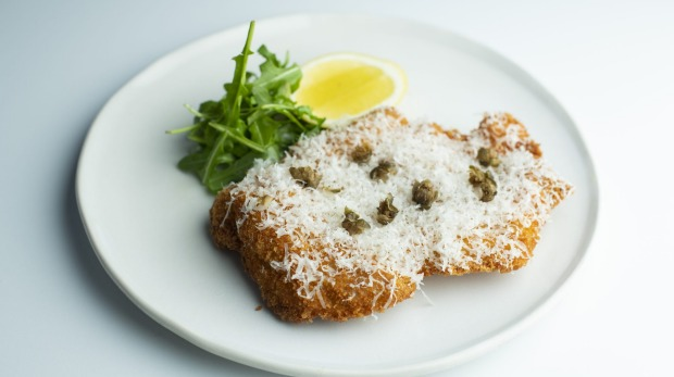 Chicken alla Milanese: parmesan and herb-crumbed chicken schnitzel with capers.