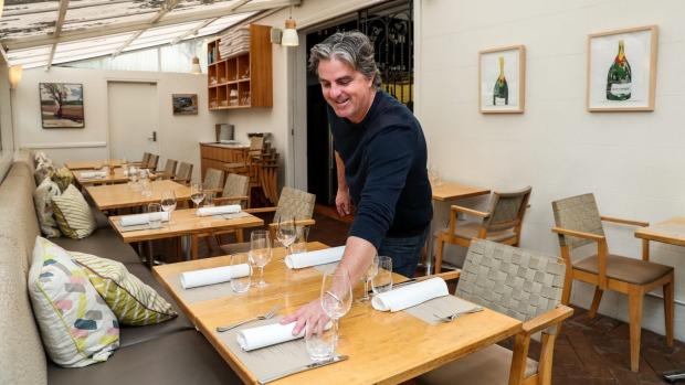 Stewart Parsons spaces out his tables at Bronte Road Bistro.