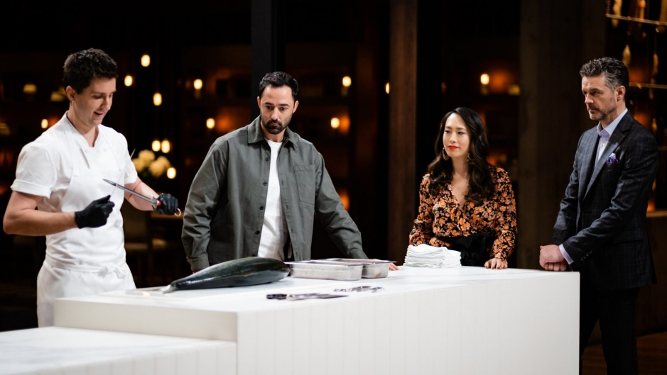 Josh Niland shows the MasterChef judges and contestants how to butcher a fish.