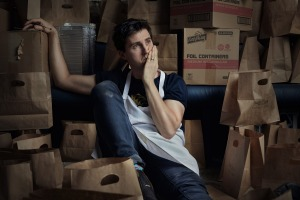 Josh Niland surrounded by takeaway packaging at Saint Peter restaurant in Sydney.
