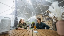 Tara and Kevin enjoy a long awaited drink during their break, in the 'igloo' at The Station Hotel in Footscray.