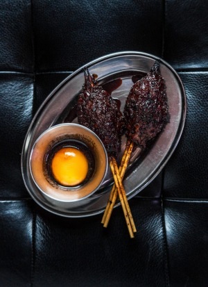 Duck meatball yakitori served with egg yolk and tare vinegar at Mono-XO, Fitzroy.
