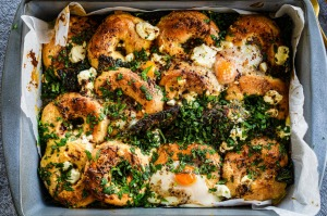 Baked eggs with mini bagels and spiced butter.