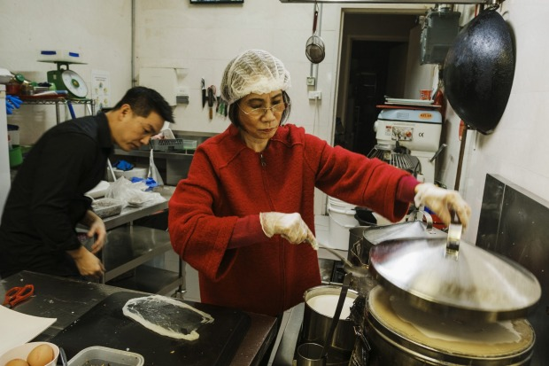 At the Banh Cuon Vietnamese shop, Anthony Dinh with his mum Kim Thanh prepare dishes.