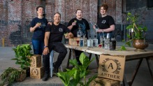 Co-distillers Dervilla McGowan and Sebastain Reaburn with their team at their mill-turned-distillery.
