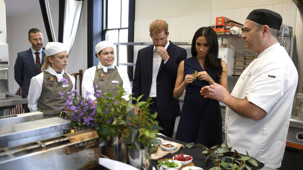 Britain's Prince Harry and his wife Meghan, the Duchess of Sussex, sample native food at the Charcoal Lane Mission Australia social enterprise restaurant in Melbourne, Australia, Thursday, October 18, 2018. The Duke and Duchess of Sussex are on a 3-week tour of Australia, New Zealand, Tonga, and Fiji and are in country to launch the 2018 Invictus Games, an Olympic-style event for disabled and ill service people. (AAP Image/AFP Pool, Andy Brownbill) NO ARCHIVING