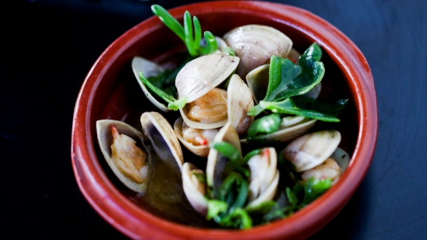 Clams opened over the fire and served in a pool of buttery juices.