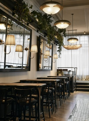 Designers have used timber, leather and marble to delineate the bar.
