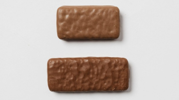 The Tim Tam, top, is smaller than it's British Penguin cousin.