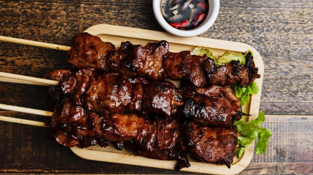 Juicy pork skewers with sweet barbecue sauce at Mama Lor Restaurant & Bakery.