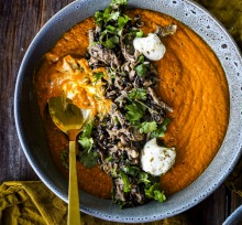 Roasted ras-el-hanout pumpkin soup with barley and leftover lamb. Soup recipes for Good Food July 2020. Please credit ...