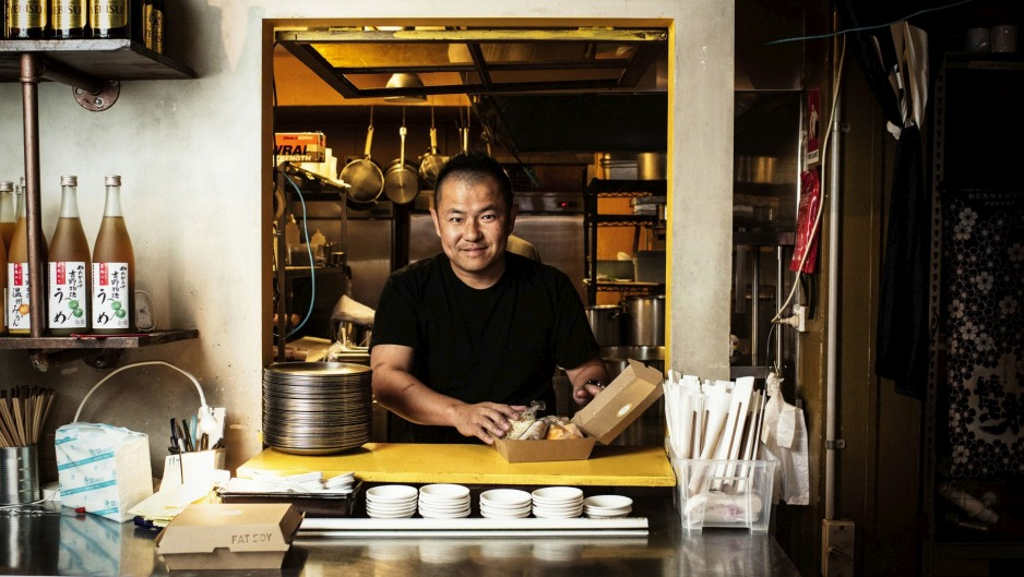 Chef and owner Keita Abe of Chaco Ramen prepares takeaway food.