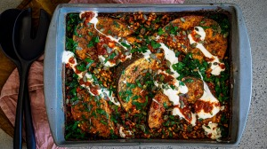 One-dish wonder: Spiced pumpkin wedges with tomato and pearl barley.