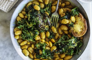 Budget-friendly beans on toast, pictured with pan-fried kale (optional).