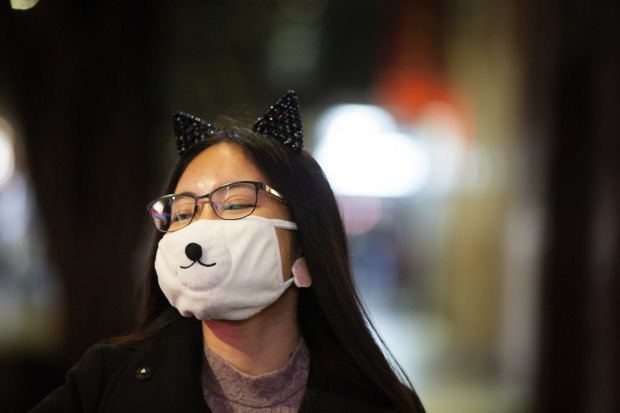 Facemasks and distance are the new normal in Chinatown.