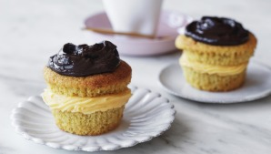 Boston cream cupcakes sandwiched with whipped coconut custard.