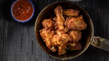 Many people enjoy wings that have a golden, sticky glaze.