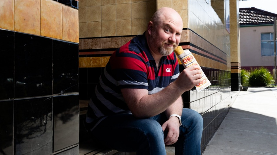 Dr Alex Russell with a Chiko Roll in Marrickville, Sydney. Nostalgia can affect how we much we like certain foods.
