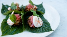 Poached prawn on betel leaf with caramelised peanut dressing.
