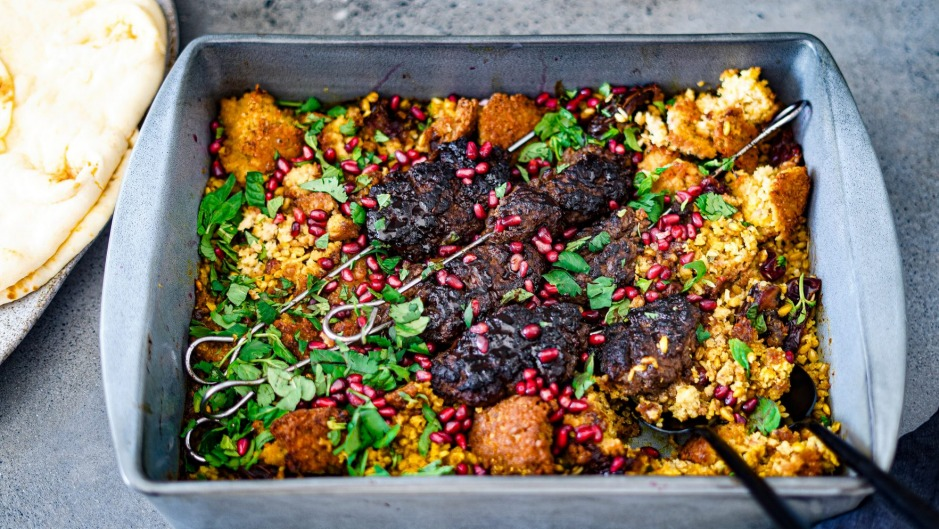 Middle Eastern one-tray wonder with lamb koftas, torn falafel and a bed of dates and grains.