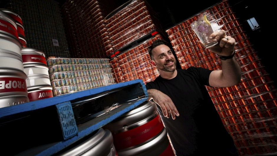 Moon Dog's group customer experience Manager Chris Hysted-Adams on the canning production line with one of the brewery's ...