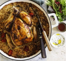 Roast chicken on baked rice with tomato, cumin and bay.