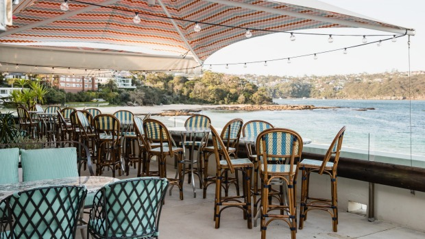 On a good day, diners can sit outside on the terrace overlooking the beach.