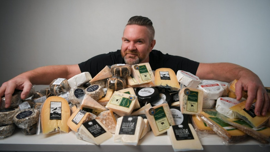 Dan Sims of Mould Collective with their cheese products.