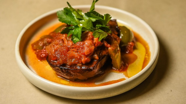 M'nazaleh, caramelised eggplant braised with tomatoes and green peppers.