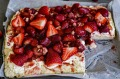 Lemonade scone slab with strawberry jam, cream and fresh strawberries.