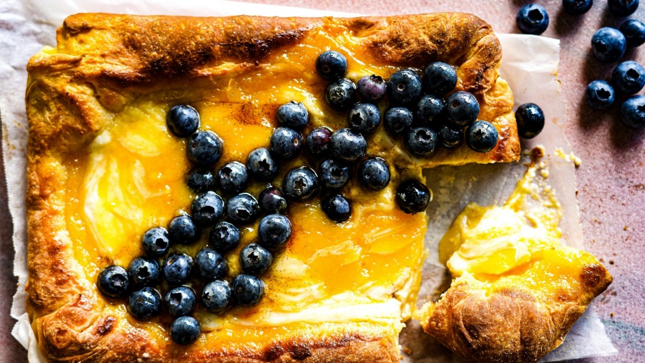 A fluffy, buttery pillow slathered with lemon curd and ricotta and scattered with berries.
