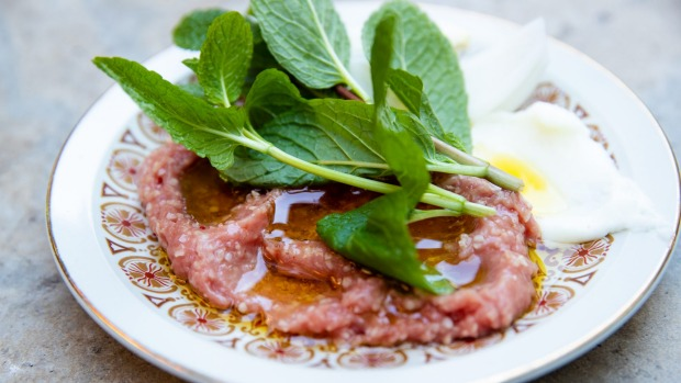 Kibbe nayeh, a pounded spread of raw beef, onion, burghul and dark, sweet spices.