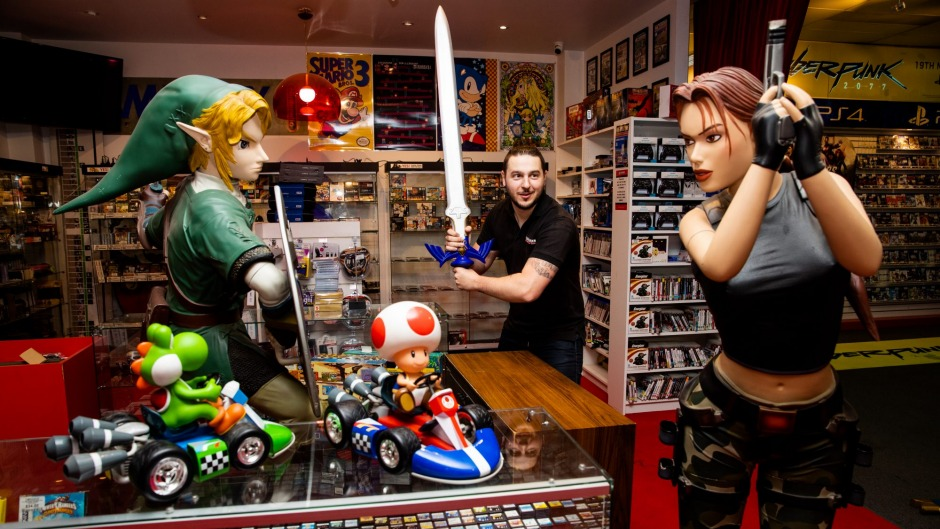 Store manager and Zelda fan Mark Dimos at the Gamesmen, Penshurst.