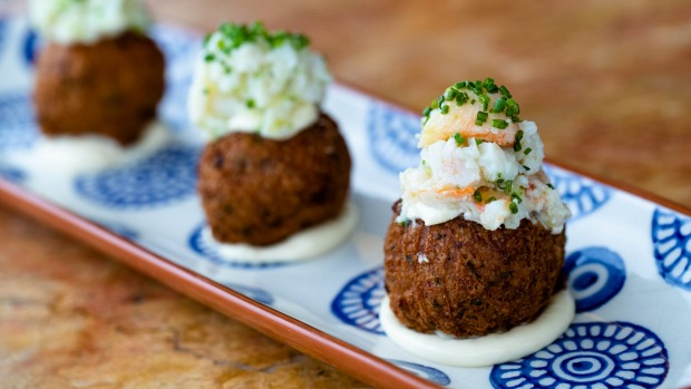 Spanner crab-topped chickpea fritters.