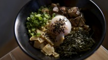 The original mazesoba includes chunks of house-made pork belly chashu, a runny onsen egg and a dusting of spring onion.
