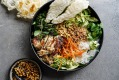 Charred lemongrass chicken spring roll bowls with chunky peanut hoisin dressing.