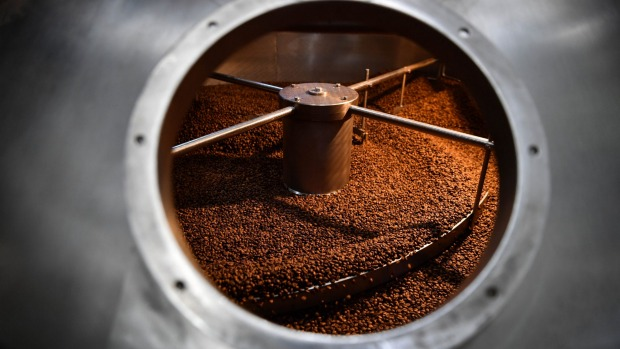 Coffee being ground at Griffths Bros coffee roasters.
