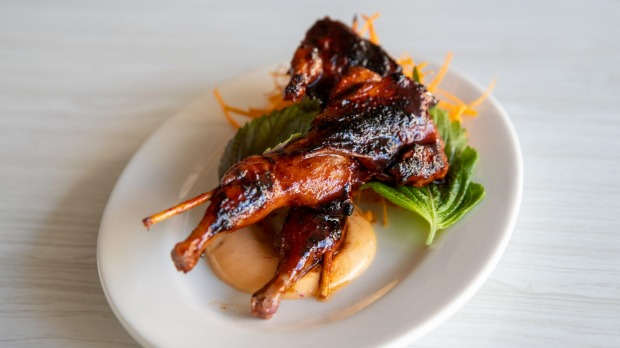 Skewered quail with ginger and sake.